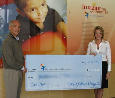 (Jim Gilbert presenting a check to our friends at the Children's Hospital Burn Unit in Denver, Colorado